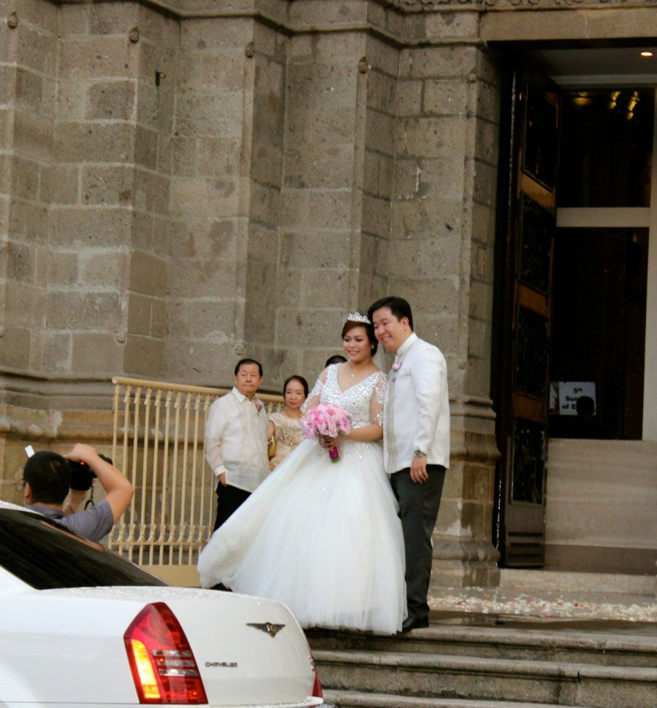A wedding happening at the Manila Cathedral, Intramurous